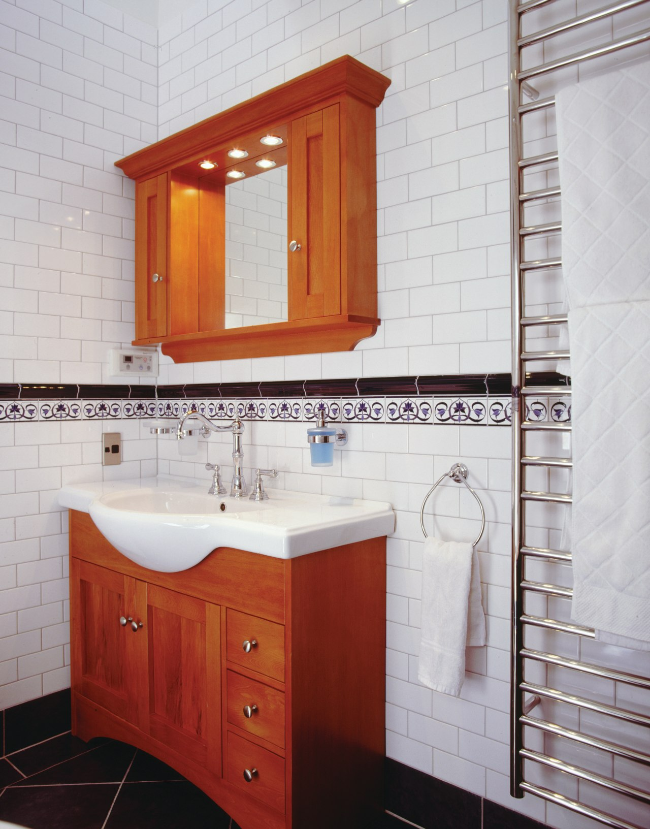 A view of some bathroomware from Plumb-Line. bathroom, bathroom accessory, bathroom cabinet, cabinetry, floor, home, interior design, room, tile, wall, wood stain, gray