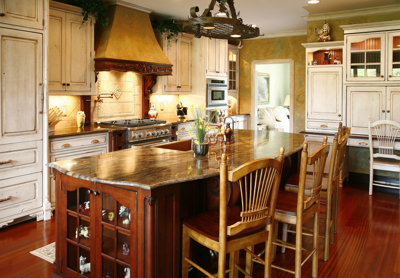 The Island's select alder cabinetry is paired with cabinetry, countertop, cuisine classique, dining room, furniture, hardwood, interior design, kitchen, room, table, wood, red, orange