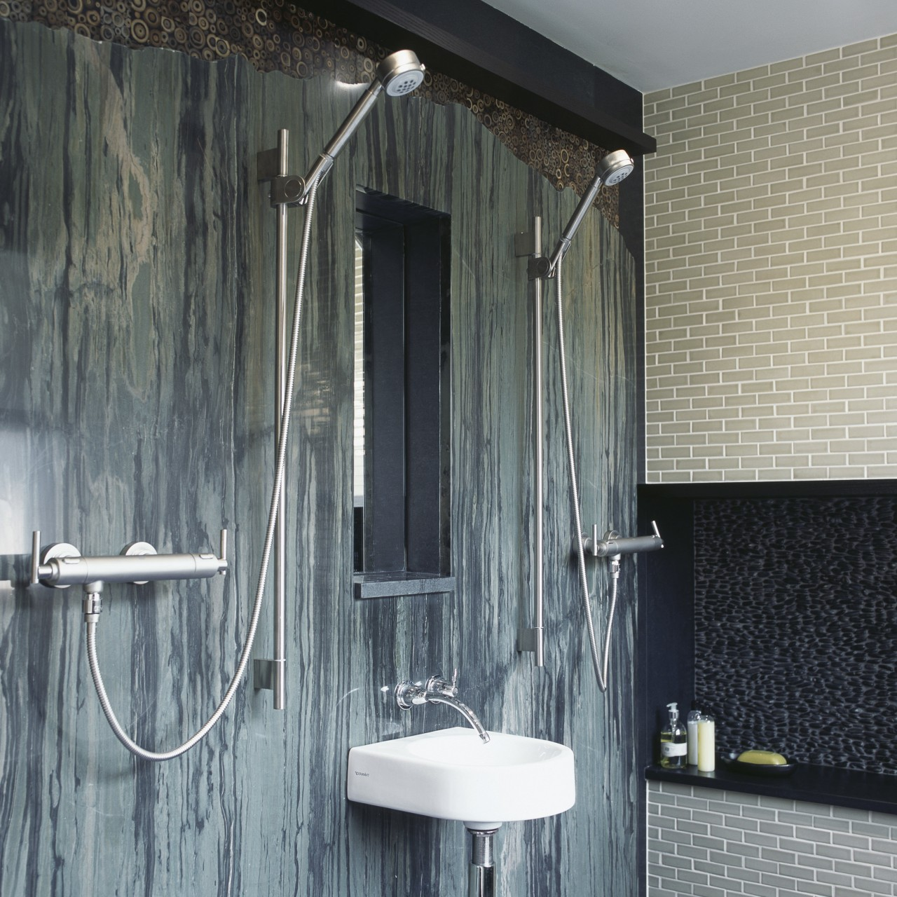 A bamboo-pattern granite forms a feature wall. The bathroom, interior design, plumbing fixture, room, wall, window, gray, black