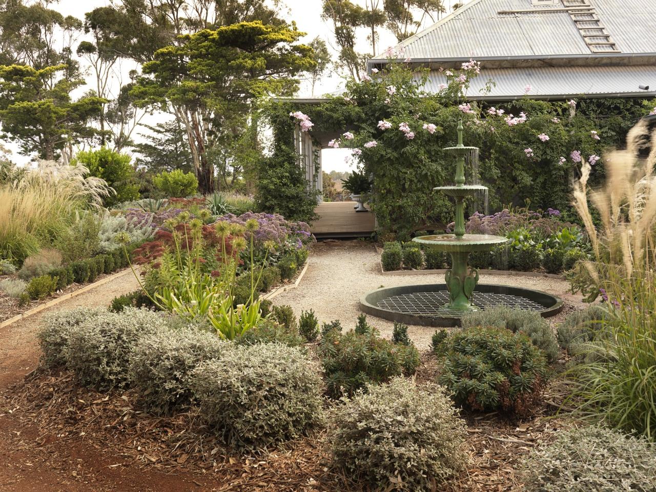 View of garden which features an antique fountain backyard, botanical garden, garden, grass, landscape, landscaping, outdoor structure, plant, tree, walkway, yard, brown