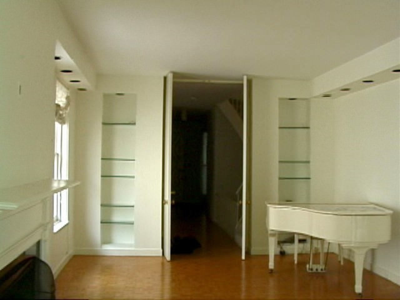 Florain has installed a glass floor panel, the apartment, ceiling, door, floor, flooring, hardwood, home, interior design, property, real estate, room, wall, window, wood flooring, orange, brown