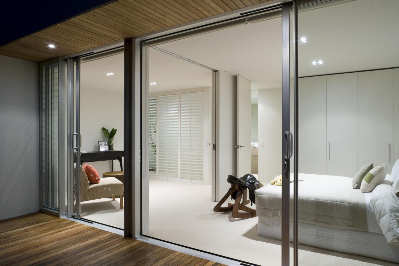 Exterior view of the master bedroom which includes door, interior design, sliding door, window, gray