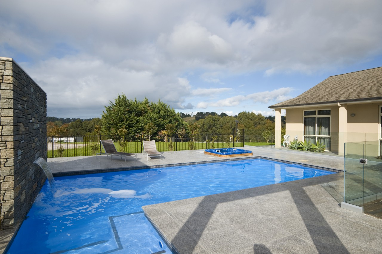 This new L-shaped pool, designed and built by estate, home, house, leisure, property, real estate, sky, swimming pool, villa, water, gray