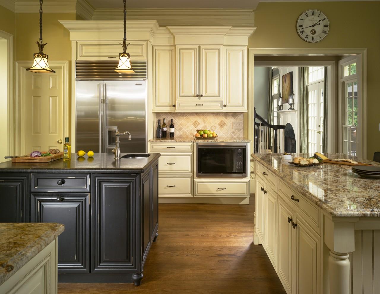 View of kitchen which features kitchen island with cabinetry, countertop, cuisine classique, floor, flooring, hardwood, interior design, kitchen, room, wood flooring, brown