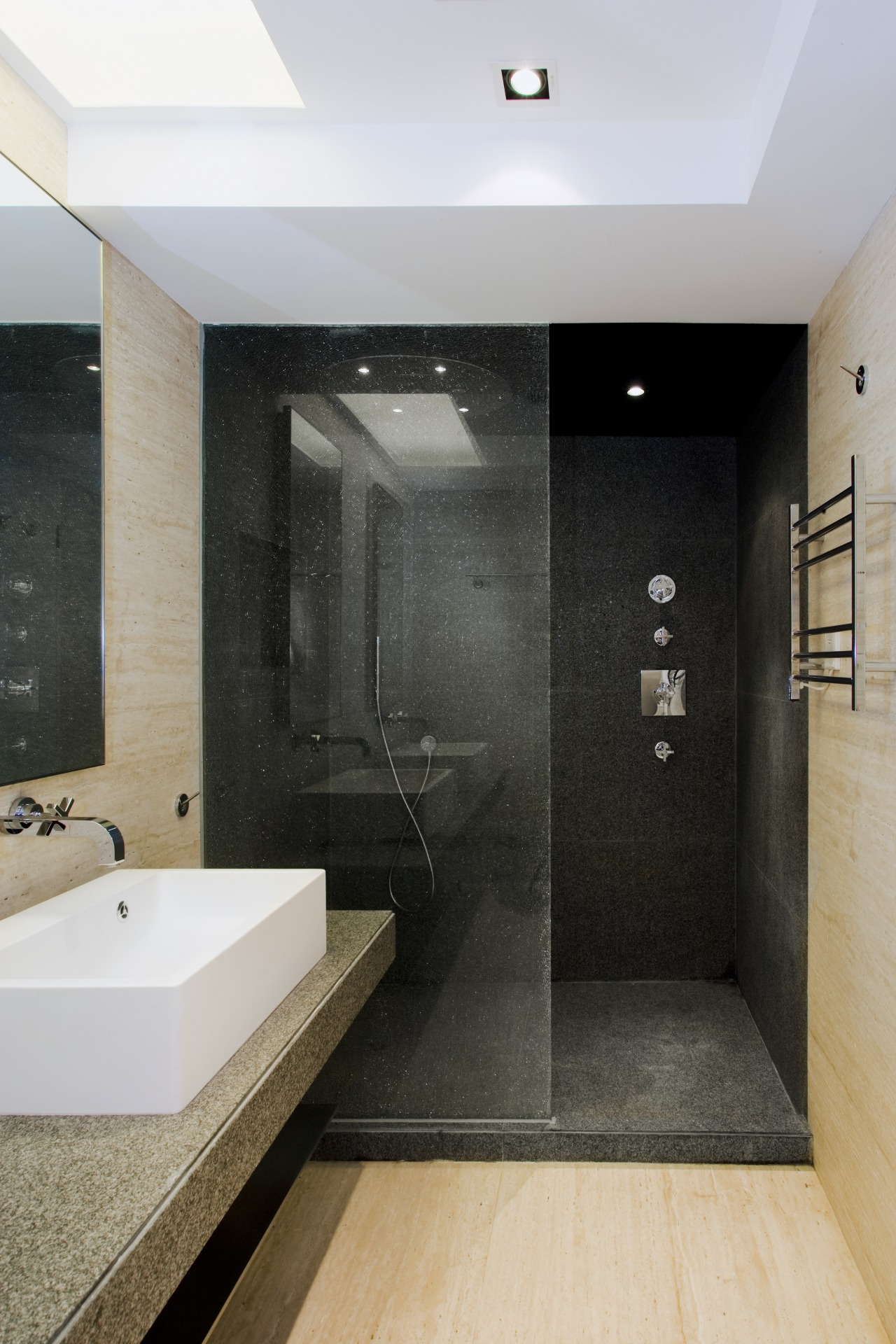 view of bathroom featuring wall and floor tiling, architecture, bathroom, floor, flooring, interior design, room, tile, black