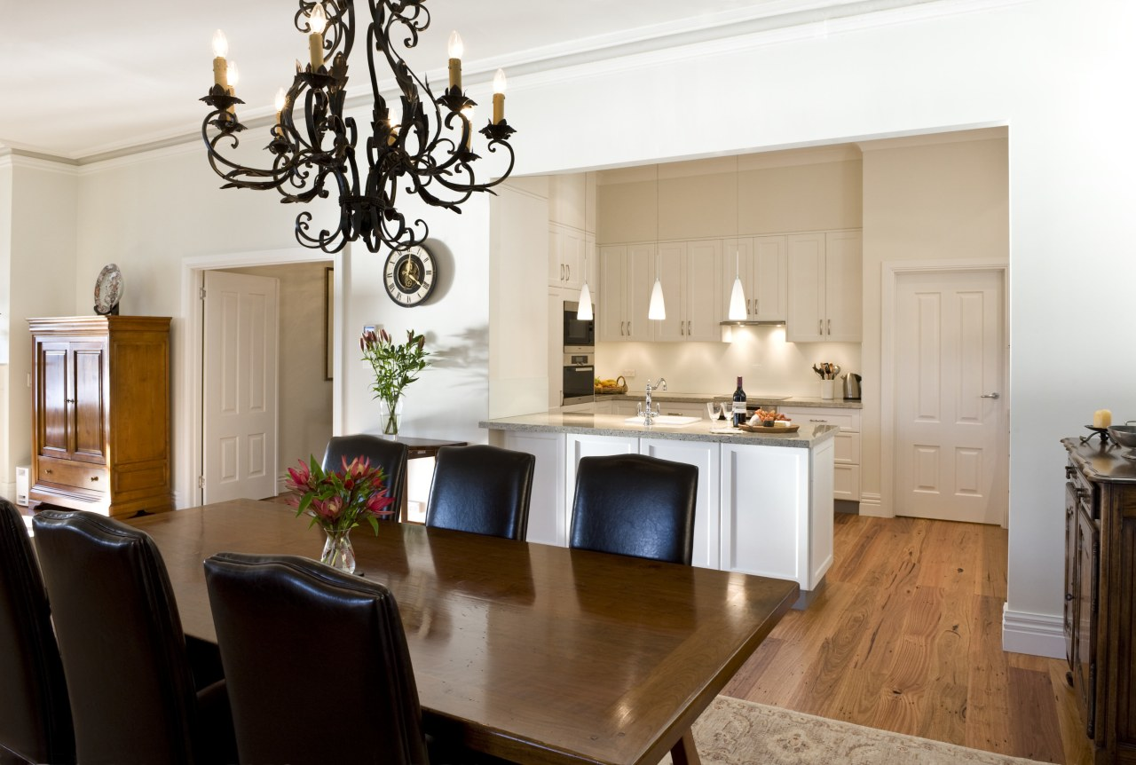 View of dining area featuring a wrought iron countertop, cuisine classique, dining room, furniture, home, interior design, kitchen, property, room, table, white