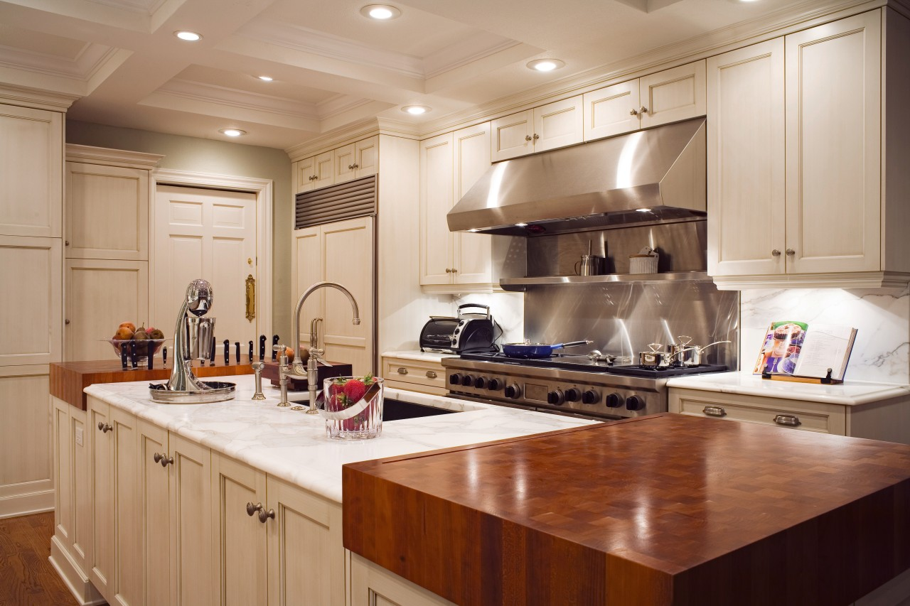 View of a kitchen which features cabinetry available cabinetry, countertop, cuisine classique, interior design, kitchen, room, brown, gray, orange