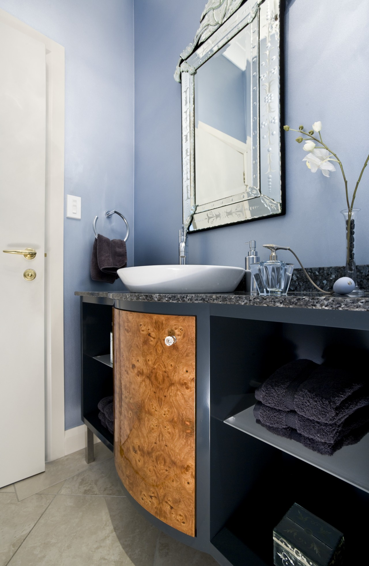 View of a powder room featuring blue painted bathroom, bathroom accessory, bathroom cabinet, cabinetry, countertop, interior design, room, sink, gray, black