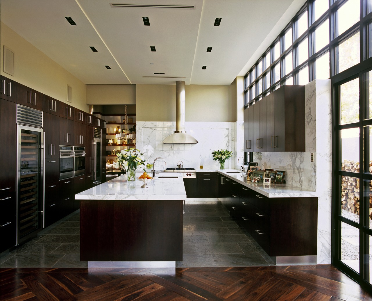 View of a new kitchen which features limestone cabinetry, ceiling, countertop, cuisine classique, flooring, interior design, kitchen, room, wood flooring, black