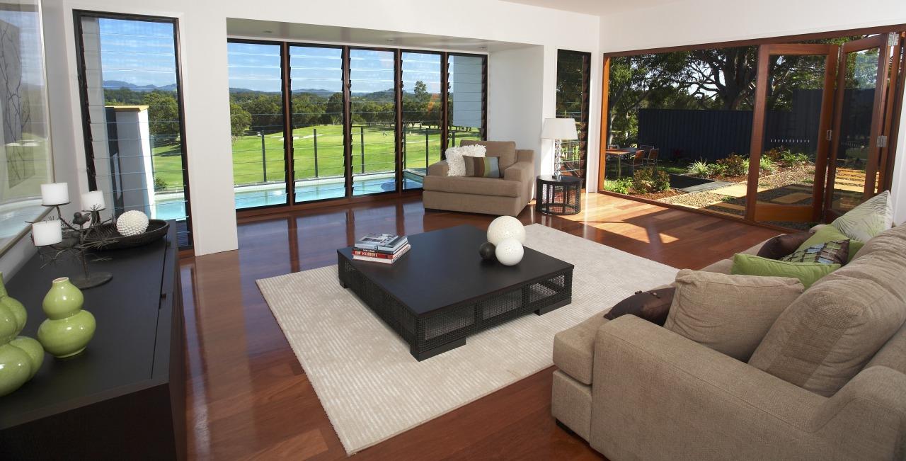 View of lounge area of a villa which door, estate, floor, flooring, hardwood, home, house, interior design, living room, property, real estate, window, wood, wood flooring, brown