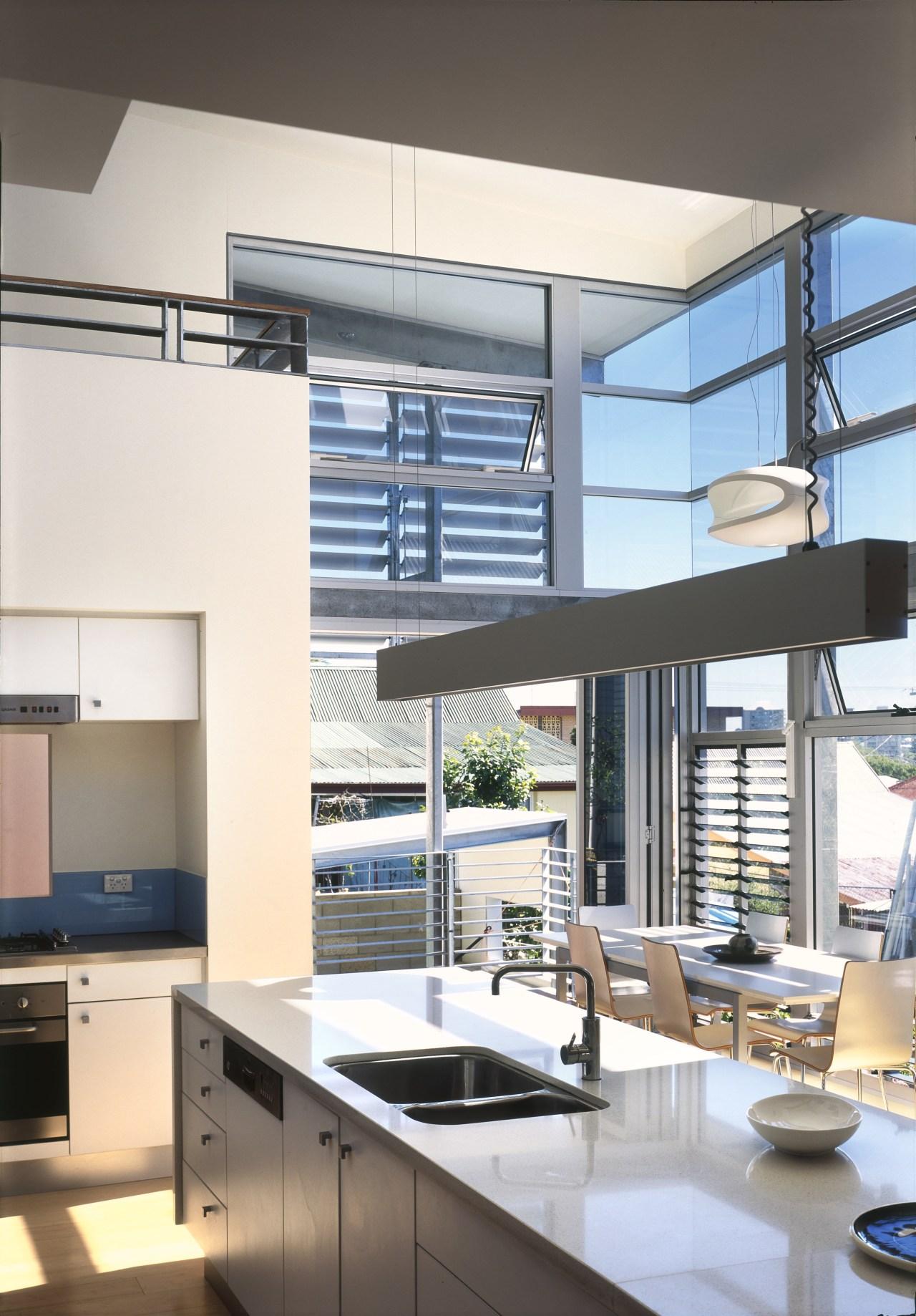 View of kitchen area a long kitchen island, countertop, daylighting, interior design, kitchen, window, white, gray
