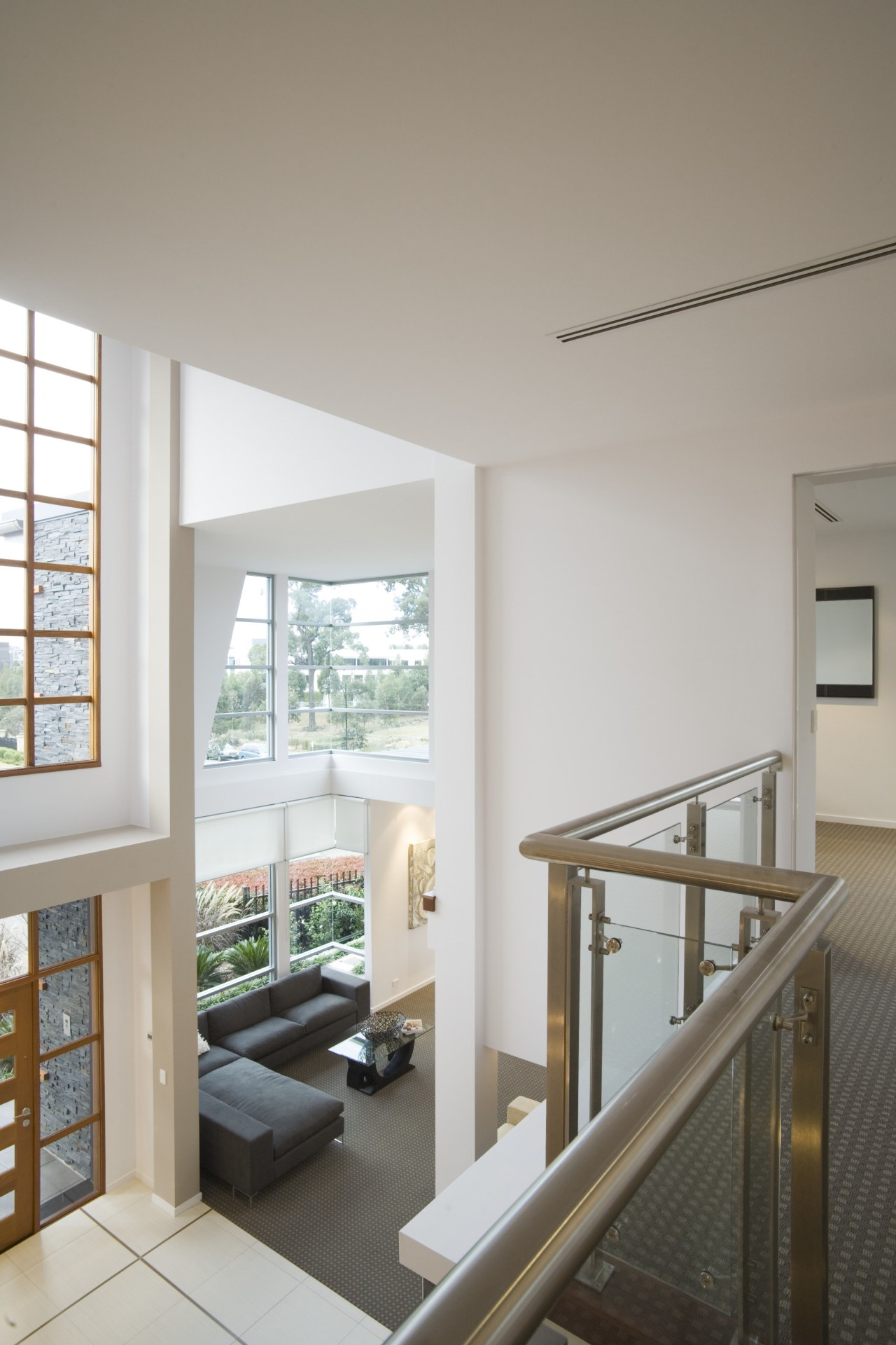 Interior view from the upper level of a architecture, daylighting, floor, handrail, home, house, interior design, living room, real estate, window, gray