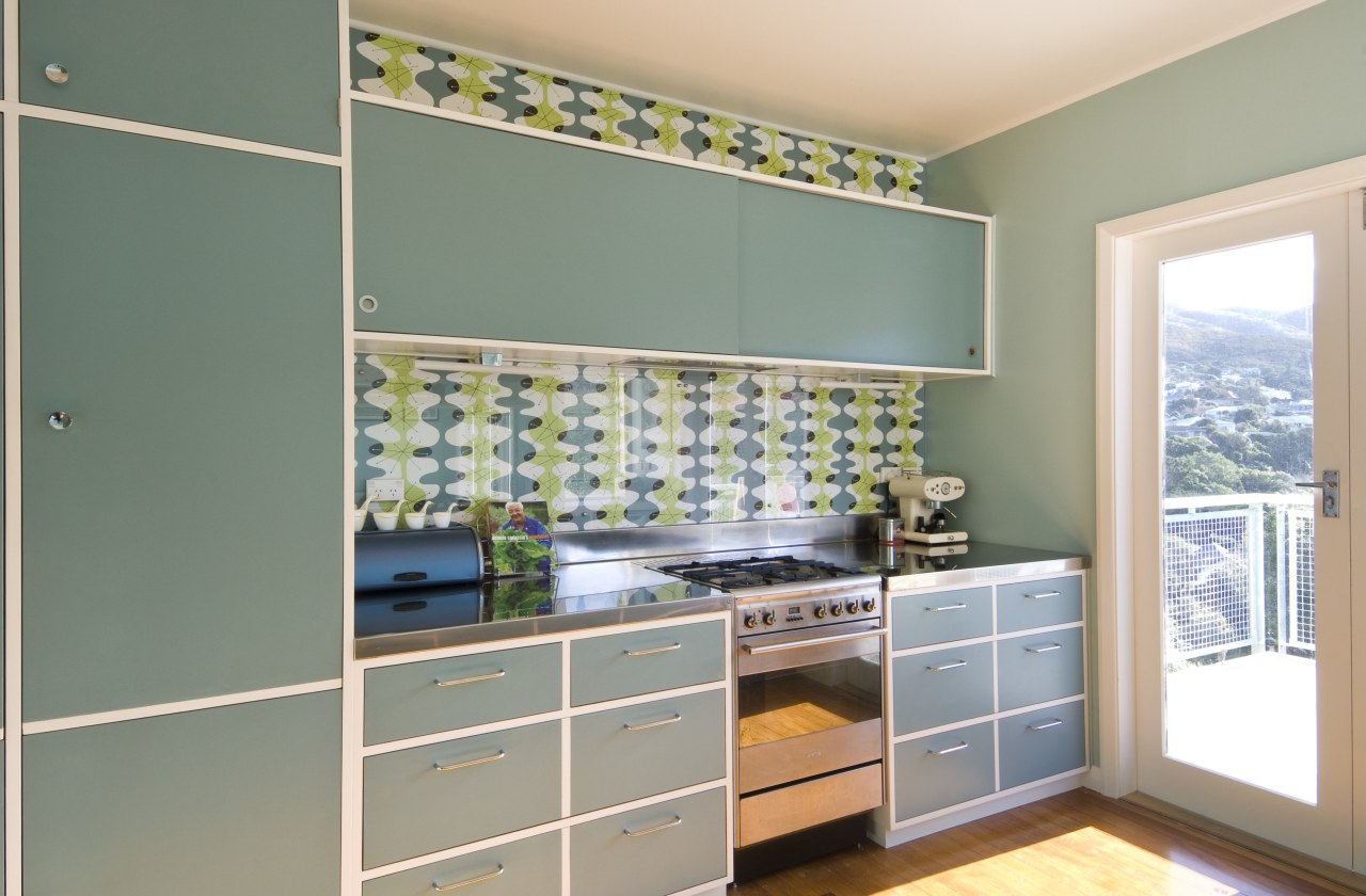 View of blue-painted kitchen cabinetry. cabinetry, countertop, home, interior design, kitchen, room, wall, window, gray