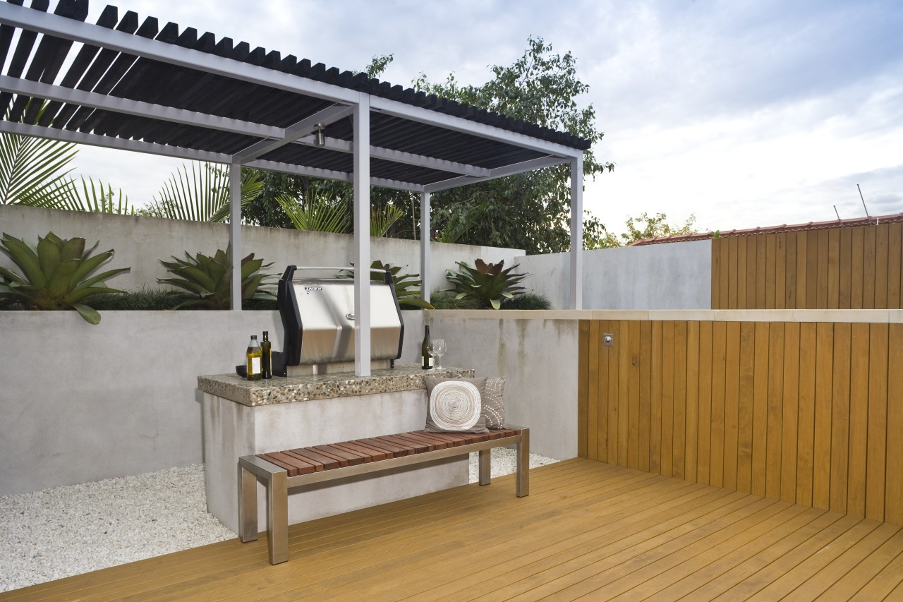 View of outdoor entertaining area which features a backyard, house, outdoor structure, property, real estate, roof, gray