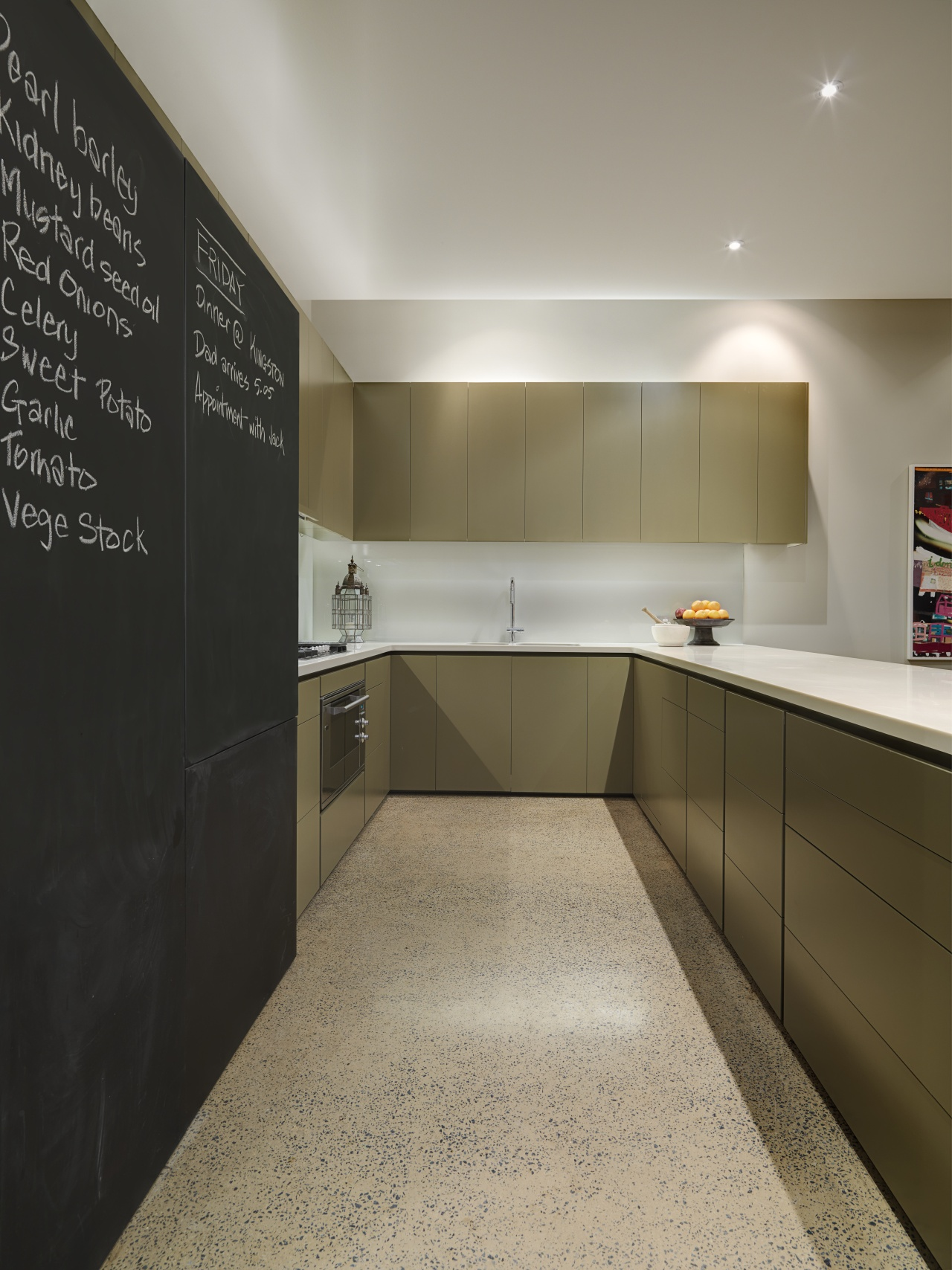 View of kitchen which features large blackboards, polished cabinetry, countertop, floor, flooring, interior design, kitchen, real estate, room, gray, brown