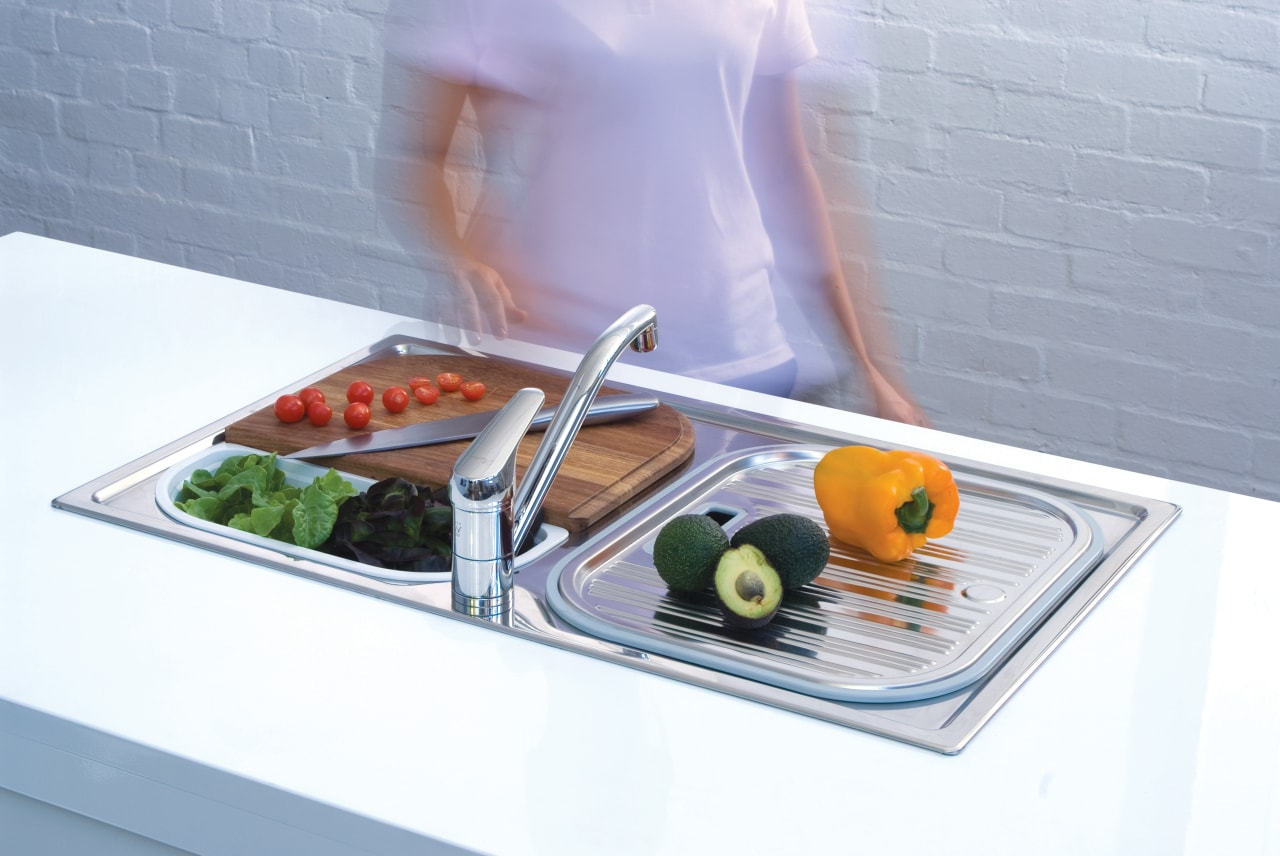 view of a kitchen which features Oliveri's new cuisine, product design, sink, table, tableware, gray, white
