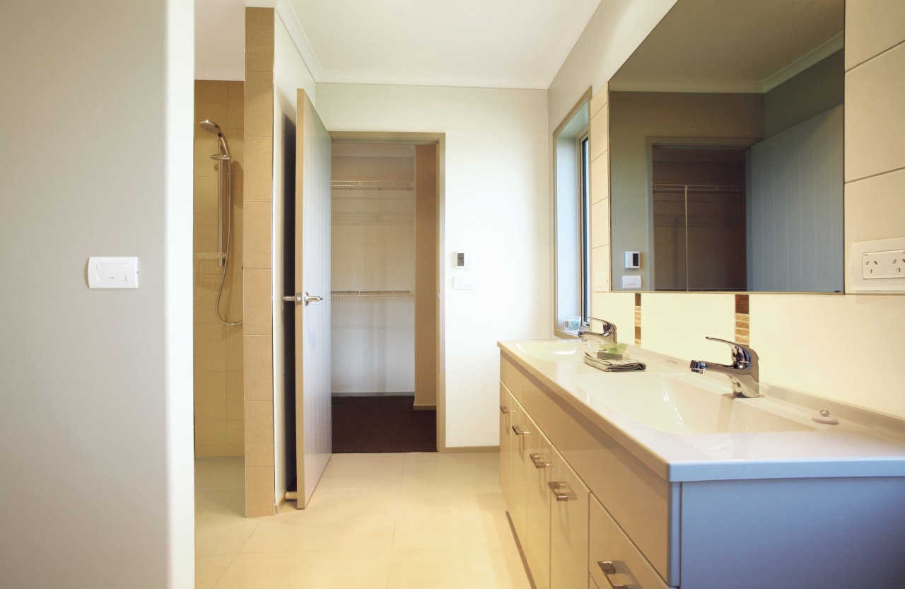 View of the bathroom of this Platinum Homes bathroom, floor, home, interior design, property, real estate, room, sink, gray