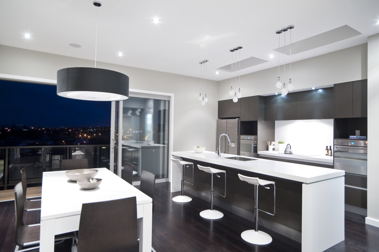 View of the kitchen and dining area of countertop, interior design, kitchen, real estate, room, white, black