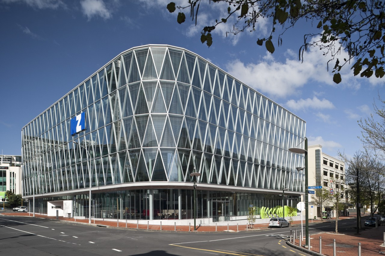 The NZI building is New Zealands first office architecture, building, commercial building, convention center, corporate headquarters, daytime, facade, headquarters, landmark, metropolis, metropolitan area, mixed use, residential area, sky, structure, gray