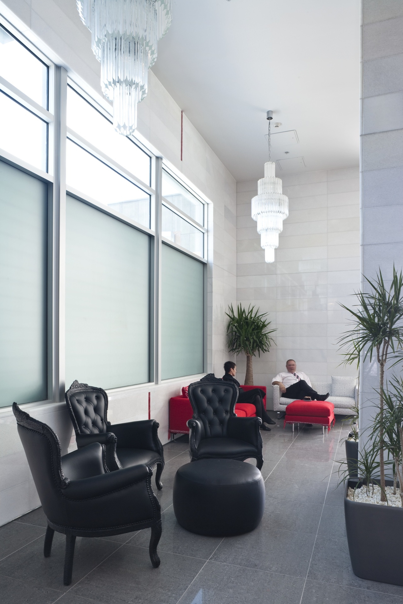The office interiors at the Club Tower reflect architecture, ceiling, floor, furniture, home, house, interior design, living room, window, white, gray