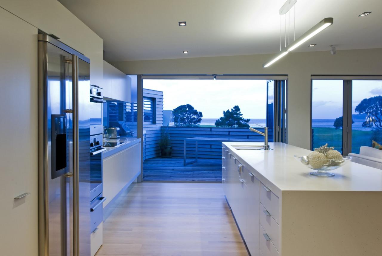This sleek kitchen in a beach house features interior design, gray