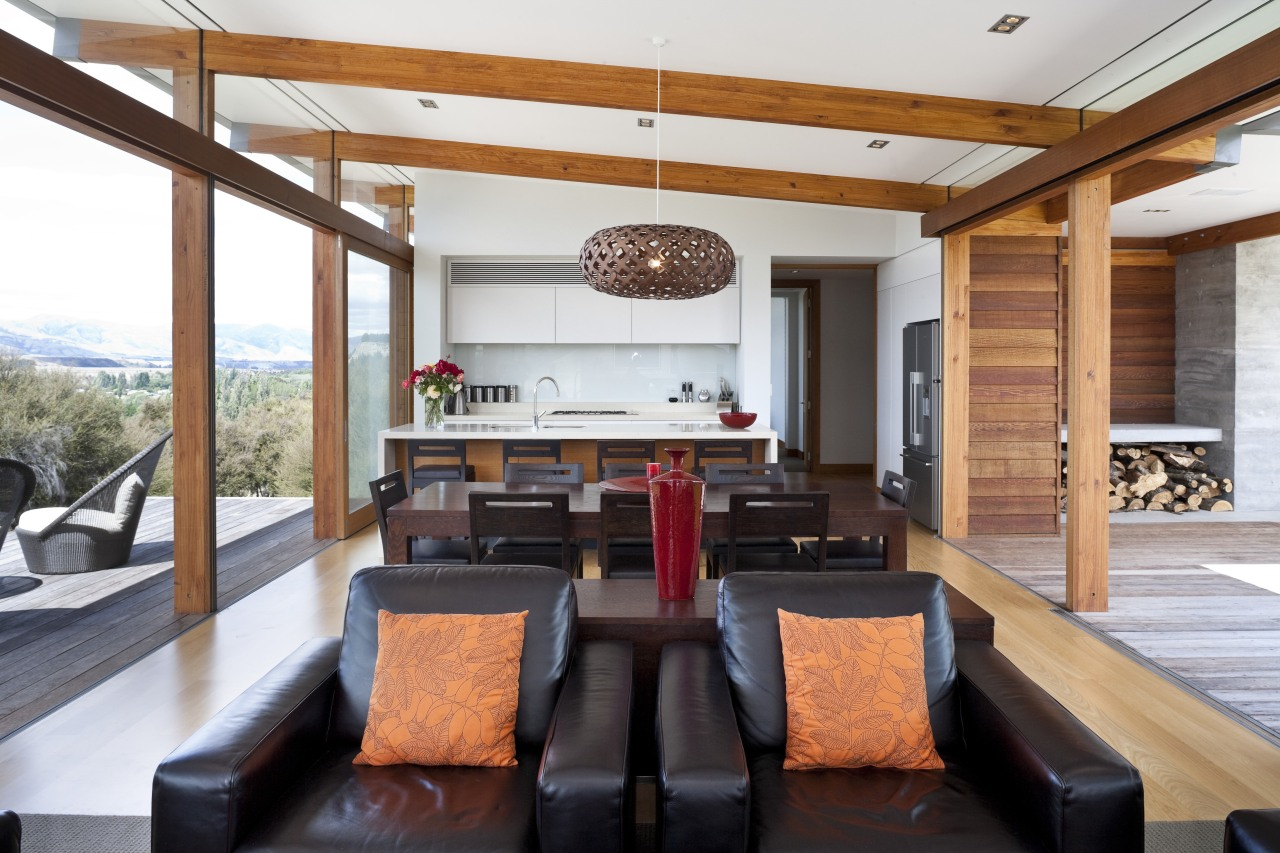 View of lunge area featuring wooden floors, leather ceiling, house, interior design, living room, real estate, white