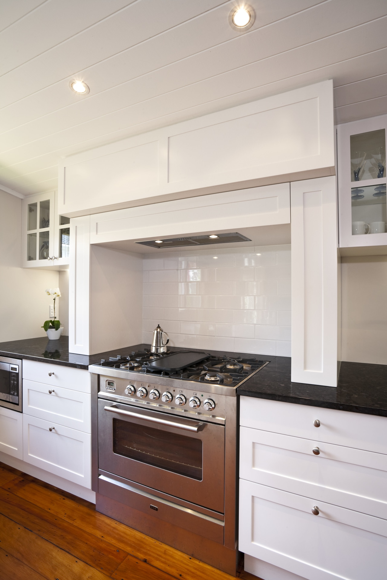 This new kitchen, by RH Cabinetmakers, features traditionally cabinetry, countertop, cuisine classique, floor, flooring, hardwood, home, home appliance, interior design, kitchen, kitchen appliance, kitchen stove, major appliance, oven, room, wood flooring, gray