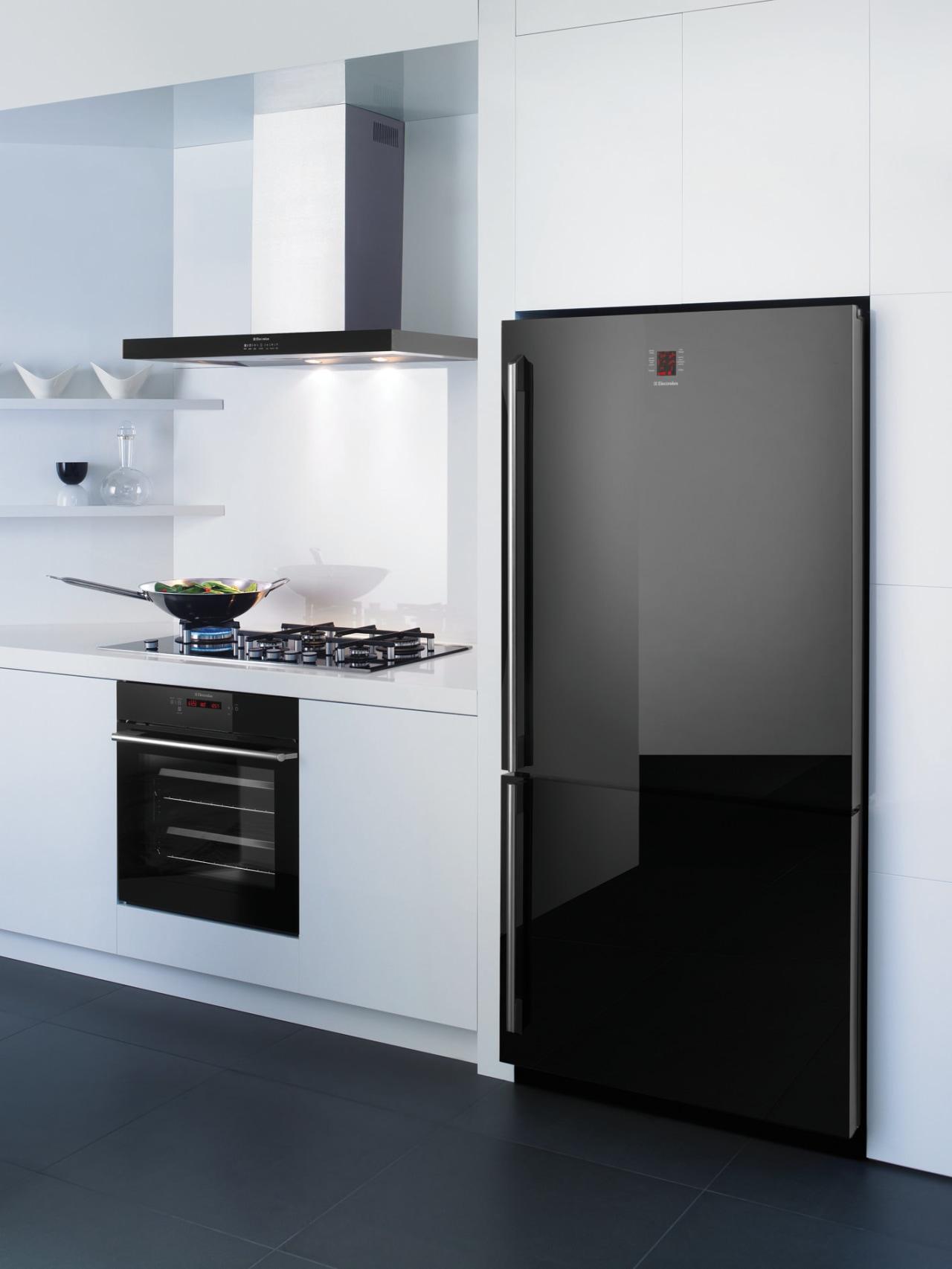 This chic kitchen features a bottom-mount refrigerator, oven, home appliance, kitchen, kitchen appliance, kitchen stove, major appliance, product, product design, refrigerator, white, black