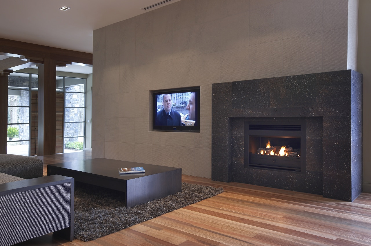 view of a living area which features a fireplace, floor, flooring, hardwood, hearth, home, interior design, laminate flooring, living room, real estate, wall, wood burning stove, wood flooring, gray, black