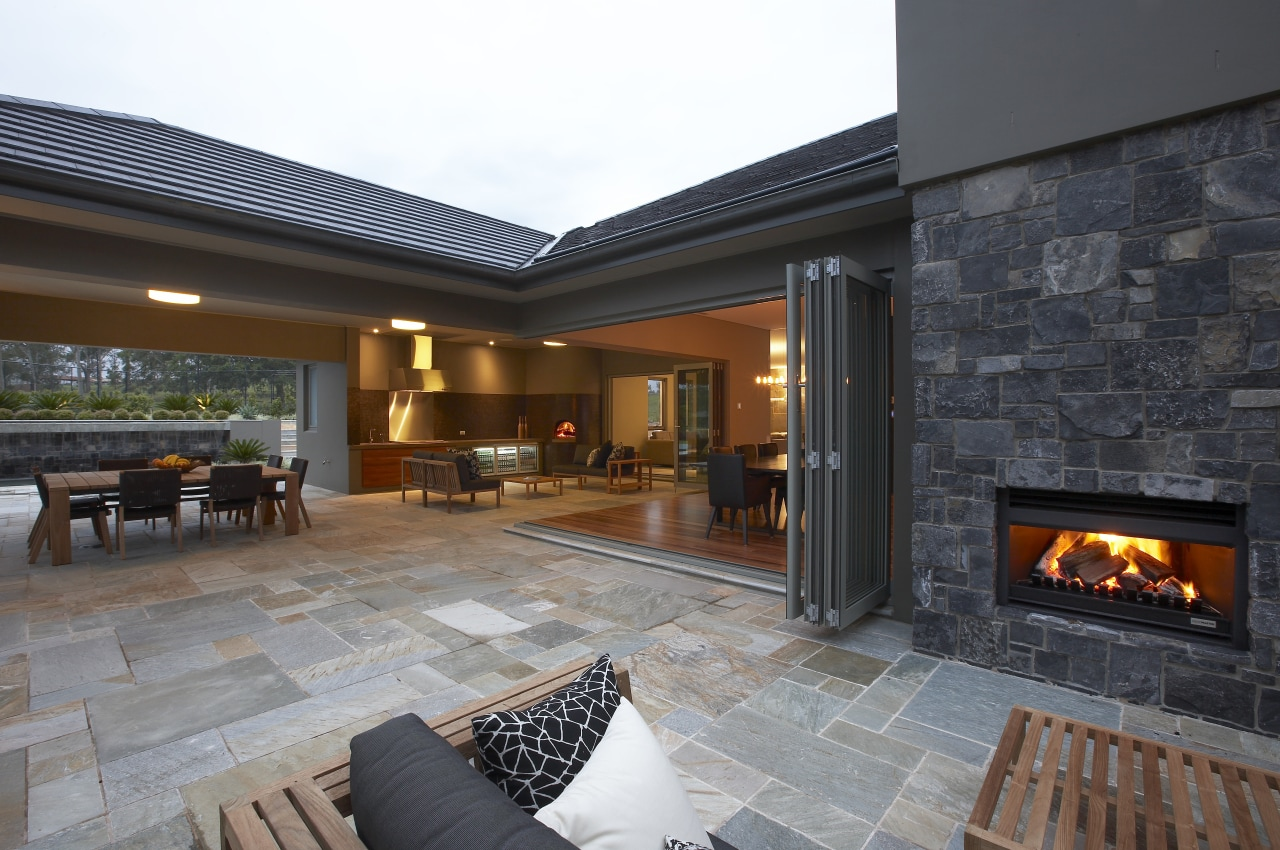 view of a living area which features a estate, fireplace, flooring, hearth, home, house, interior design, living room, lobby, real estate, black, gray