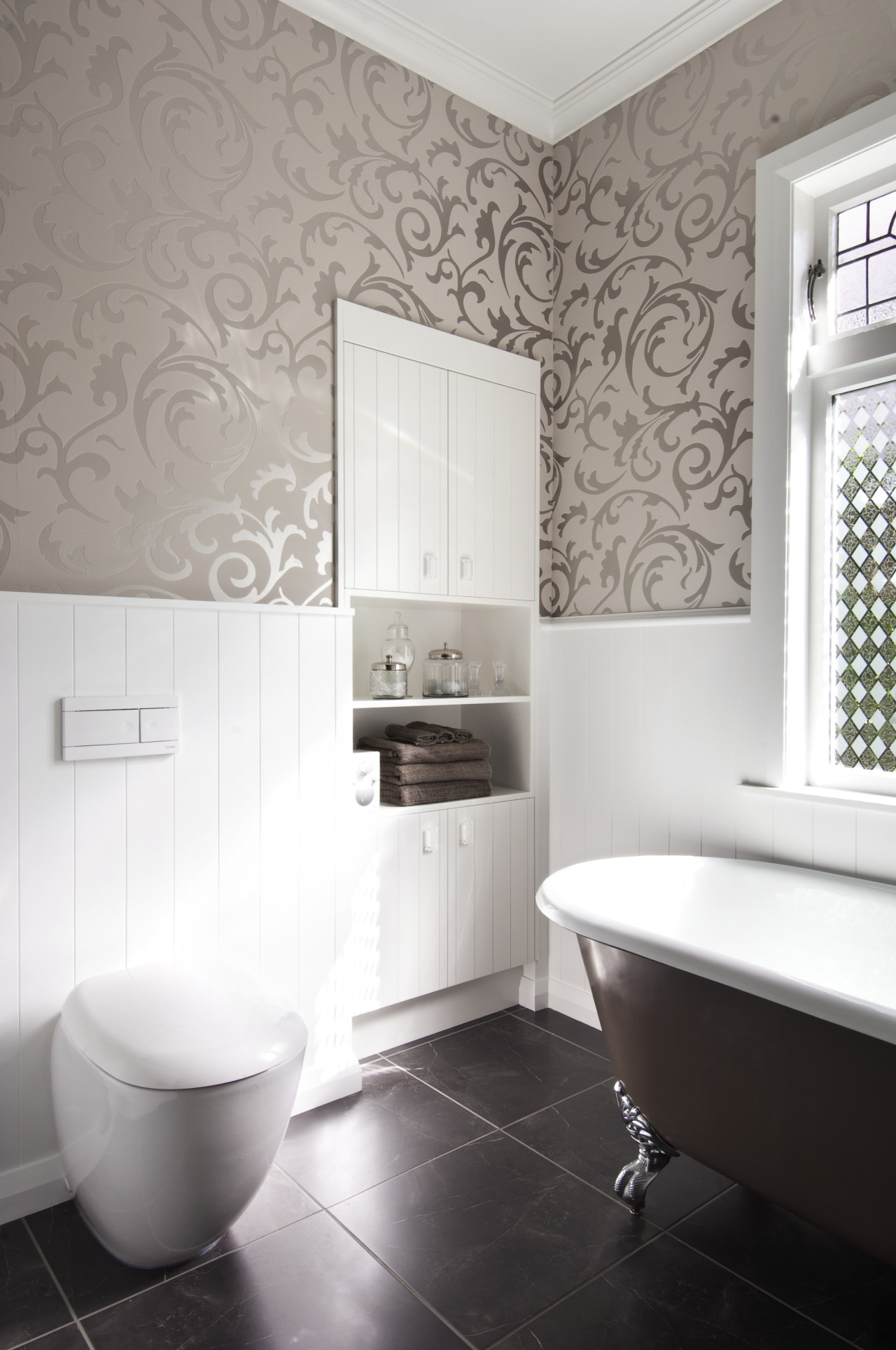 View of bathroom in a 1930s bungalow designed bathroom, bathroom accessory, bidet, ceramic, floor, flooring, interior design, plumbing fixture, product design, room, tap, tile, toilet, toilet seat, wall, window, white, gray