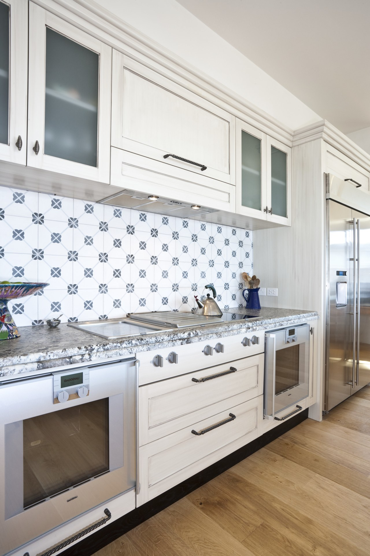 View of oven cooking area cabinetry, countertop, cuisine classique, floor, flooring, home, home appliance, interior design, kitchen, room, wall, window, white
