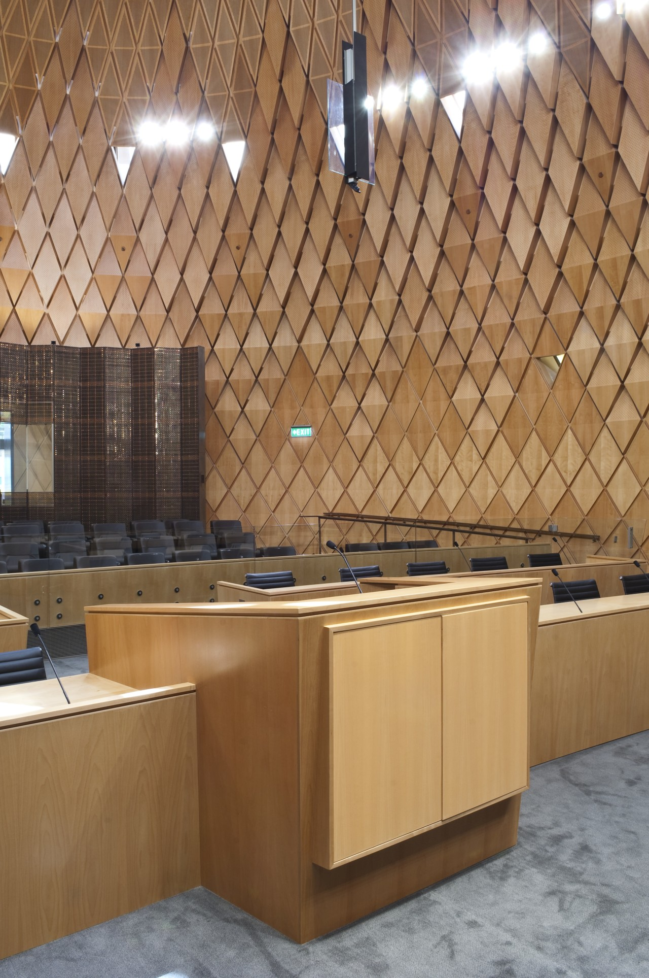 Interior view of the Supreme Court which features architecture, ceiling, countertop, daylighting, floor, flooring, hardwood, interior design, plywood, tile, wall, wood, brown, orange