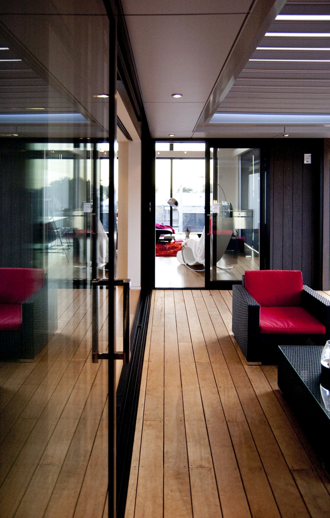 Interior view of this contemporary home apartment, architecture, floor, flooring, hardwood, house, interior design, window, wood, wood flooring, black