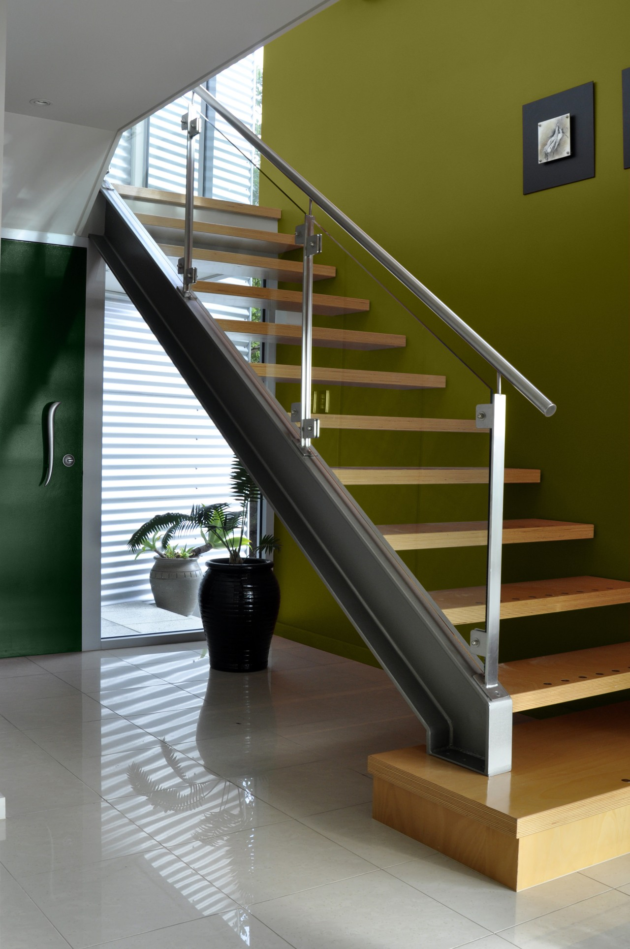 View of the stairway which features paint from baluster, floor, glass, handrail, home, interior design, product design, stairs, brown