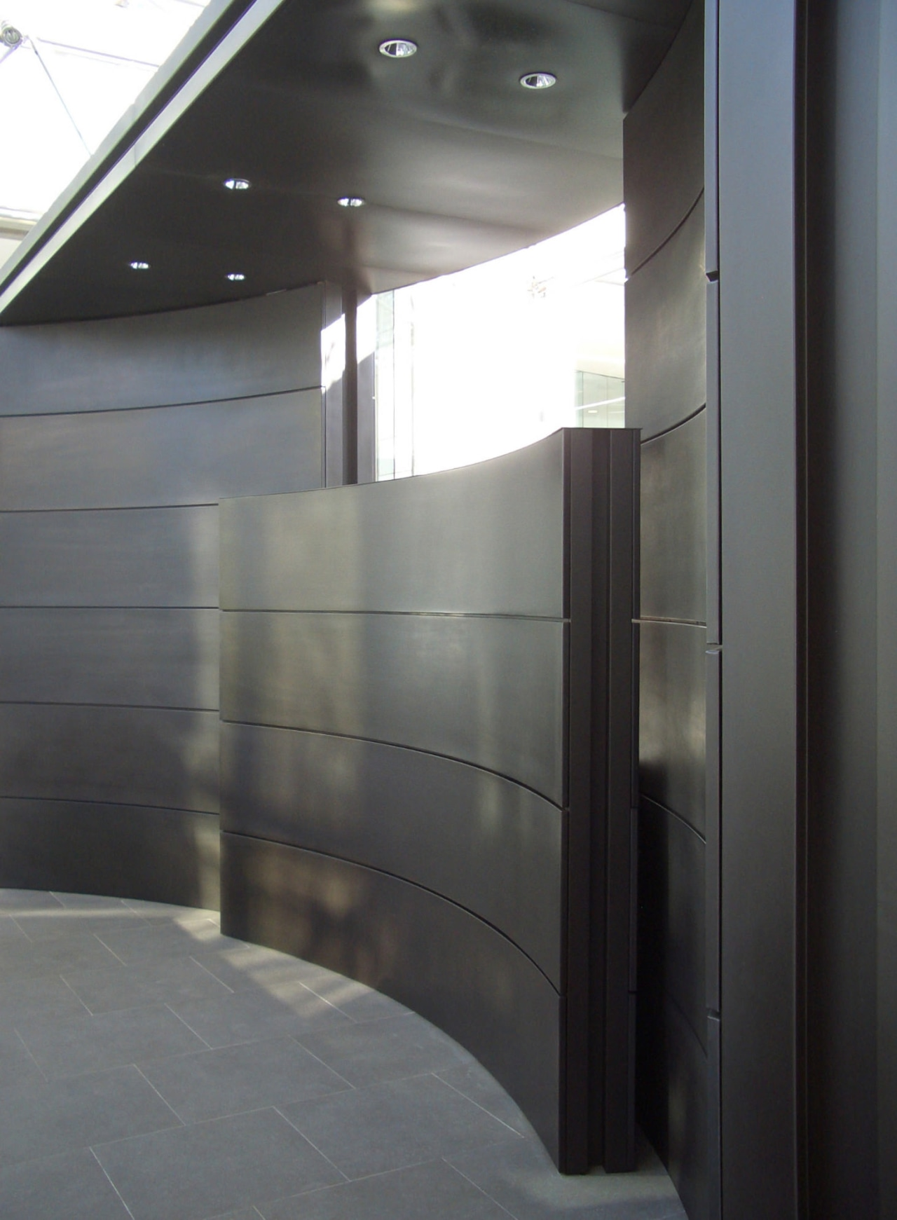 View of brass walls fabricated by Craft Metals architecture, daylighting, glass, gray, black