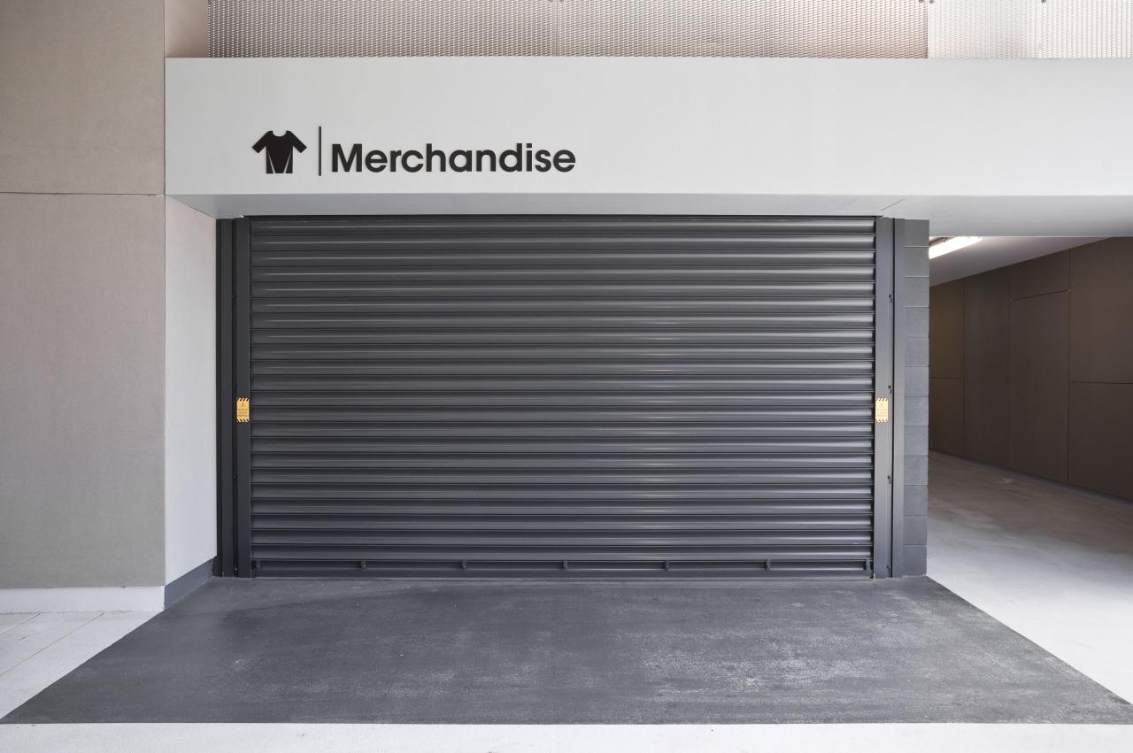 View of a metal roller door at the building, door, garage, garage door, real estate, gray, white