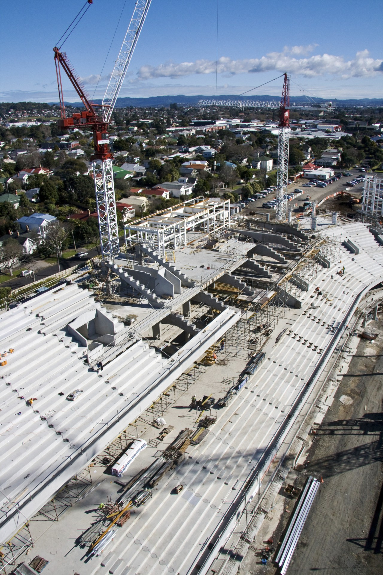 View of Eden Park's new South Stand which aerial photography, bird's eye view, building, city, construction, metropolis, metropolitan area, sky, transport, urban area, white