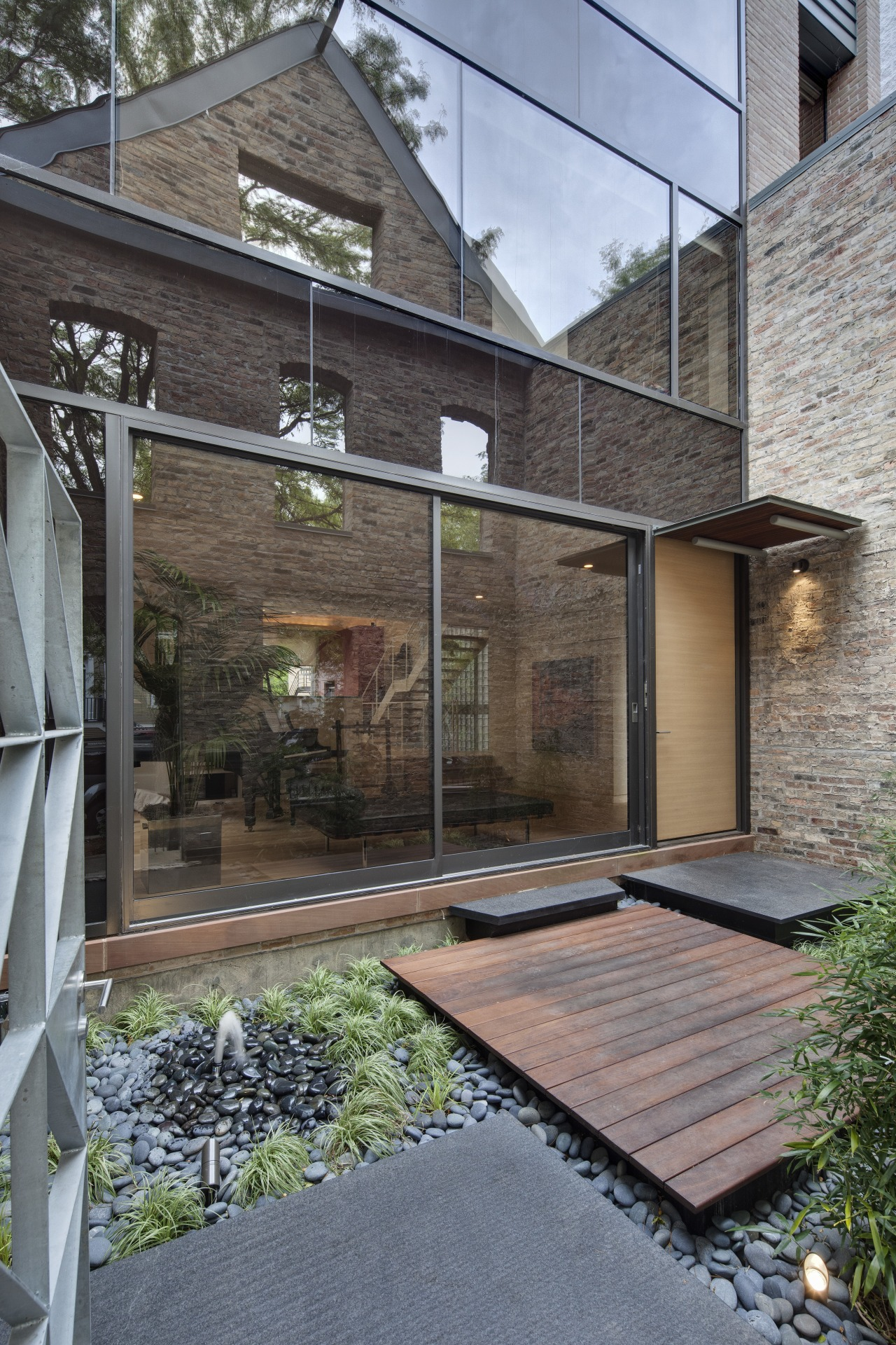 View of a renovated three-story home, built to architecture, courtyard, facade, home, house, outdoor structure, real estate, residential area, siding, gray