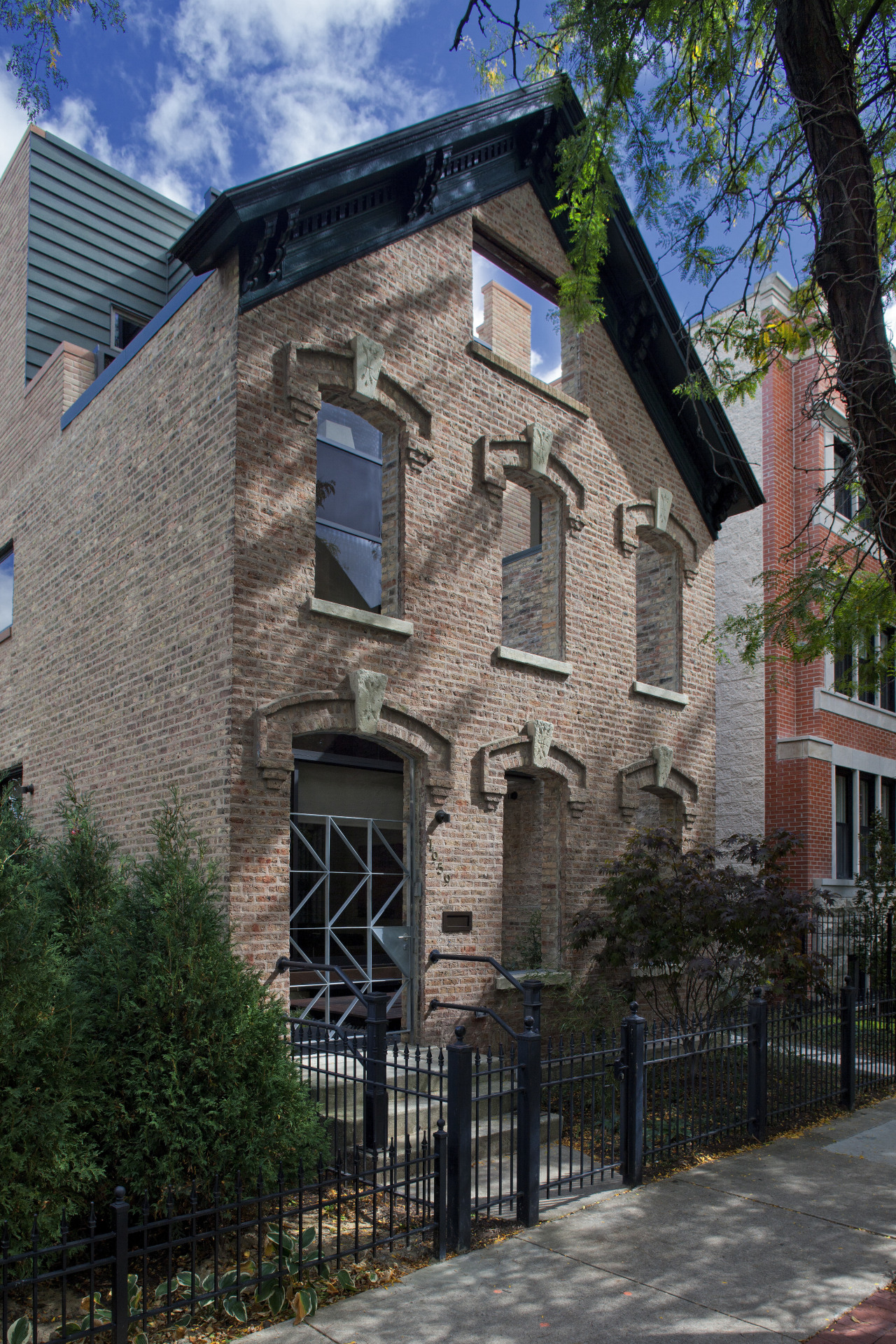 View of a renovated three-story home, built to apartment, architecture, building, city, cottage, estate, facade, historic house, home, house, landmark, mansion, neighbourhood, property, real estate, residential area, tree, window, black, gray