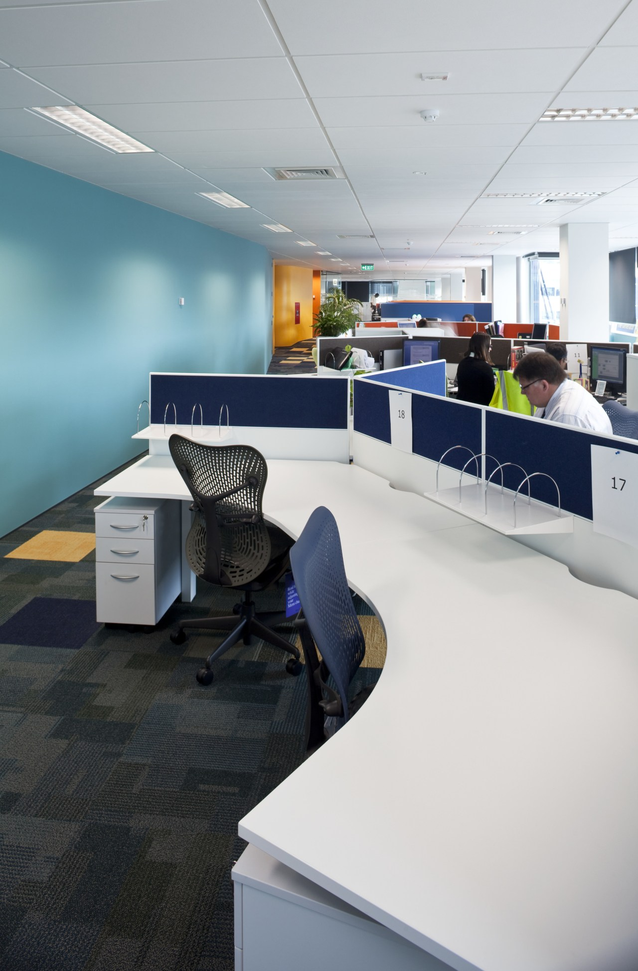 Interior view of Mercury Energy offices which features architecture, furniture, interior design, office, product design, table, gray