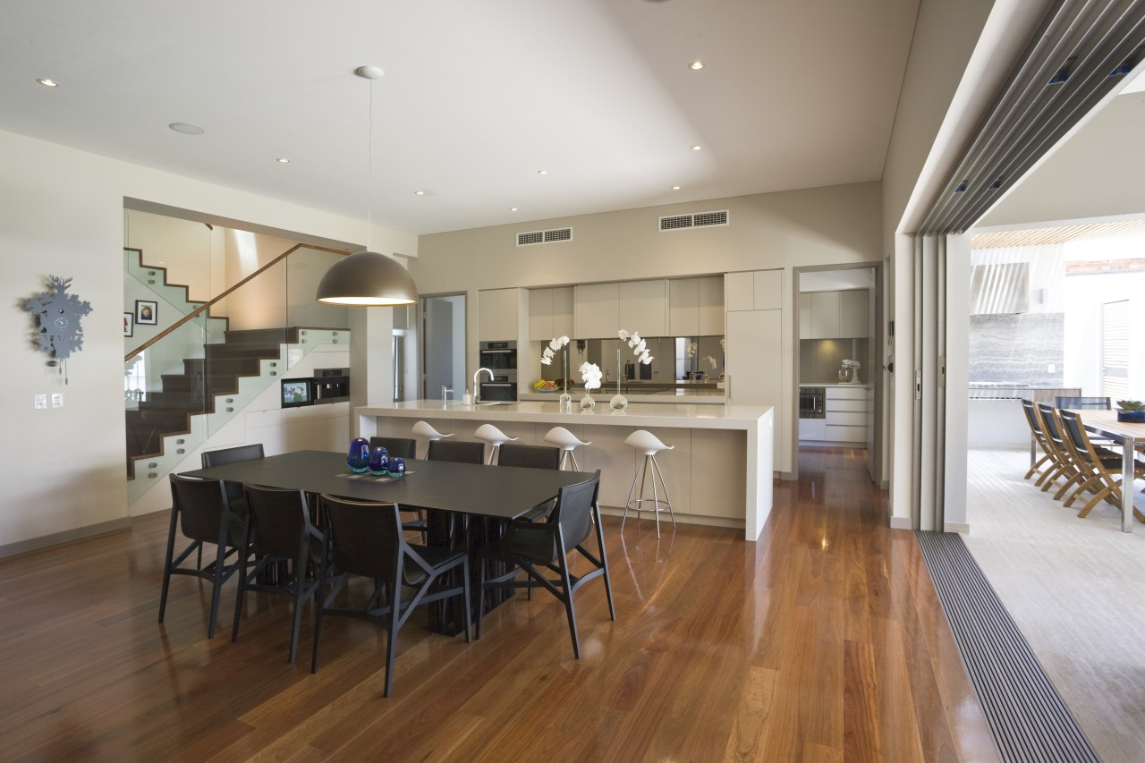 View of large, open renovated kitchen featuring timber ceiling, dining room, floor, flooring, hardwood, house, interior design, kitchen, property, real estate, room, wood flooring, gray, brown