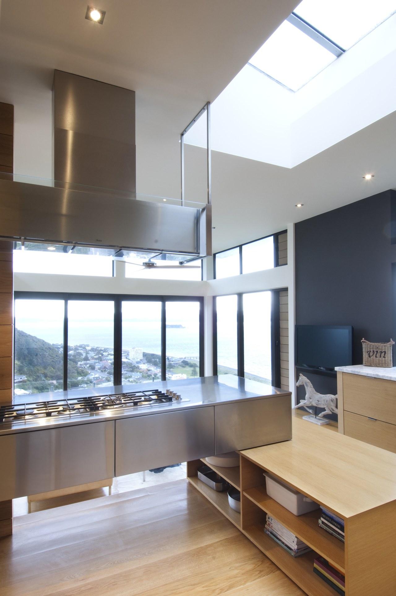 Raised floor kitchen. Stainless steel Binova cooktop. American architecture, daylighting, interior design, kitchen, white, gray