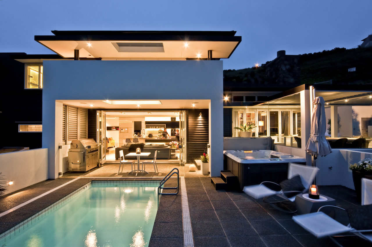 View of DJ Hewitt Builders home with plastered estate, home, house, property, real estate, swimming pool, villa, blue