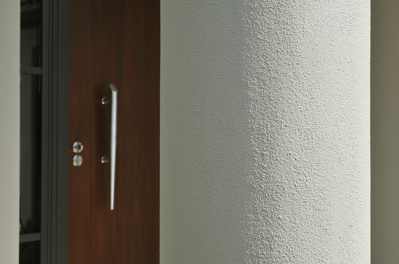 View of exterior cladding on a David Reid door, wall, wood, wood stain, gray