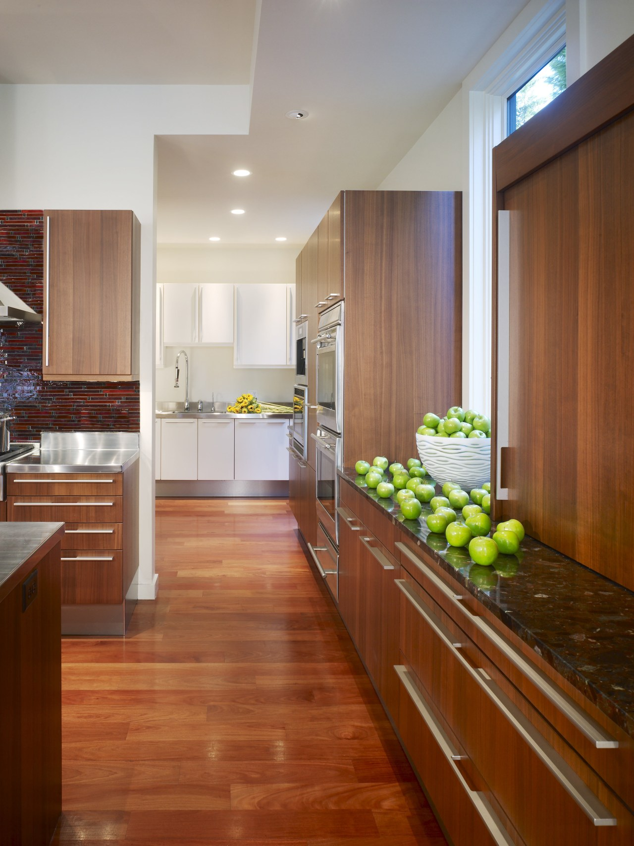 View of a kitchen which combines commerical touches cabinetry, countertop, floor, flooring, hardwood, interior design, kitchen, laminate flooring, real estate, room, wood, wood flooring, brown, gray