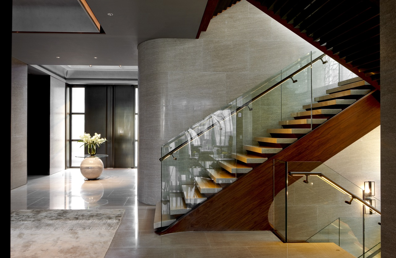 View of stairway in a contemporary home. architecture, handrail, interior design, lobby, stairs, gray