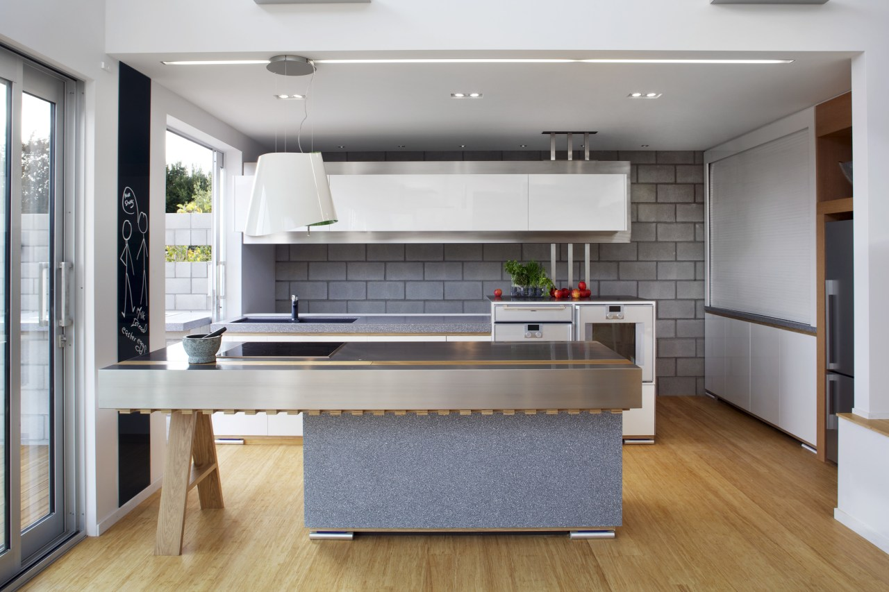 This kitchen features stainless steel benchtops. It was countertop, interior design, kitchen, real estate, gray