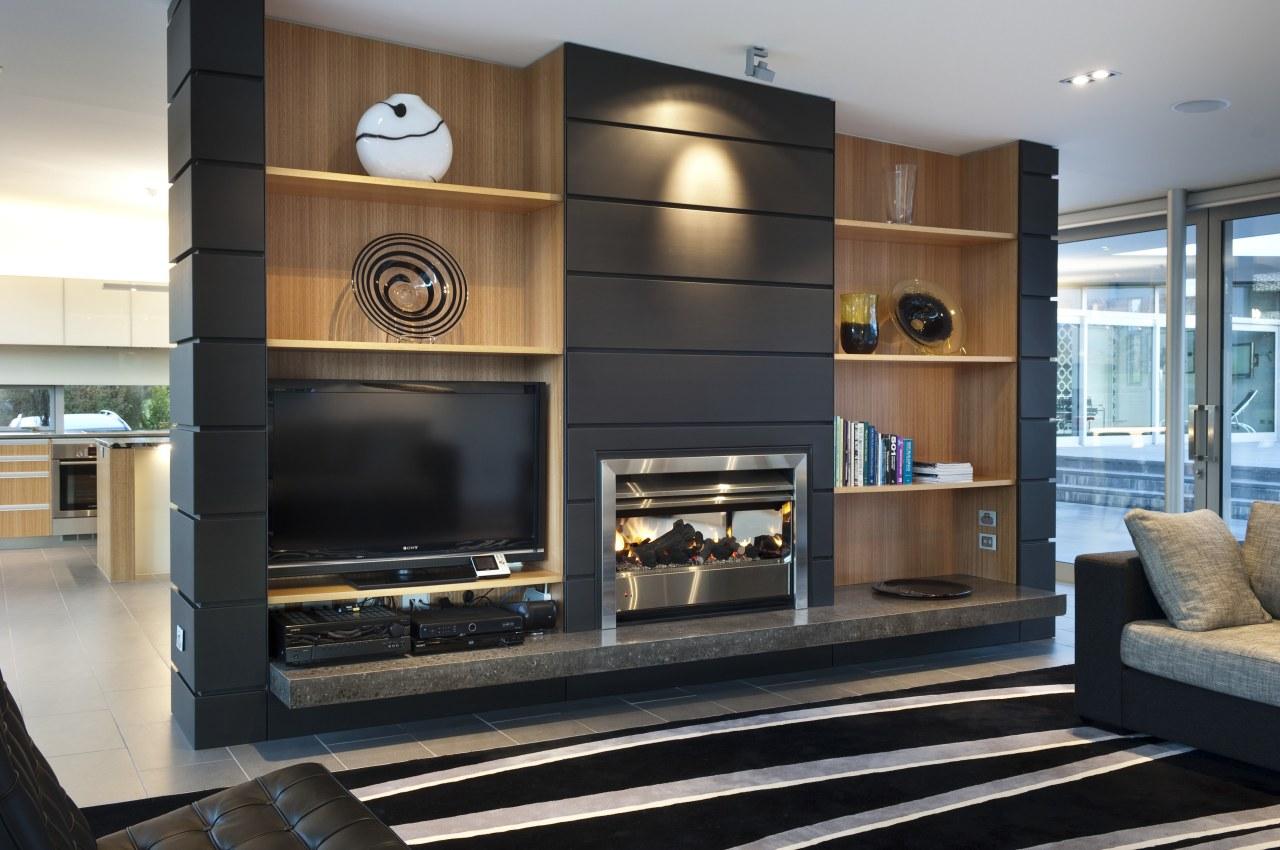 View of dark-toned indoor fireplace. furniture, interior design, living room, black