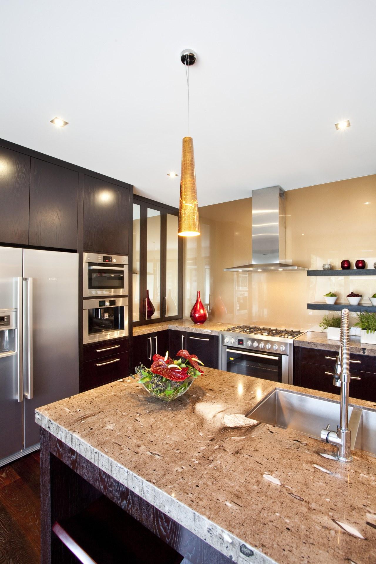 Balinese design influence. Dark-roasted American oak floorboards. Mousse countertop, interior design, kitchen, real estate, white